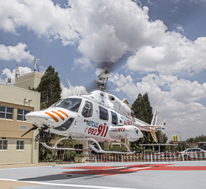Regional operations manager of Netcare 911 HEMS, Deon Swart, explains that the purpose-built Bell 222 UT helicopters are fitted with the latest in diagnostic, ventilation and monitoring equipment. Photo: Netcare 911